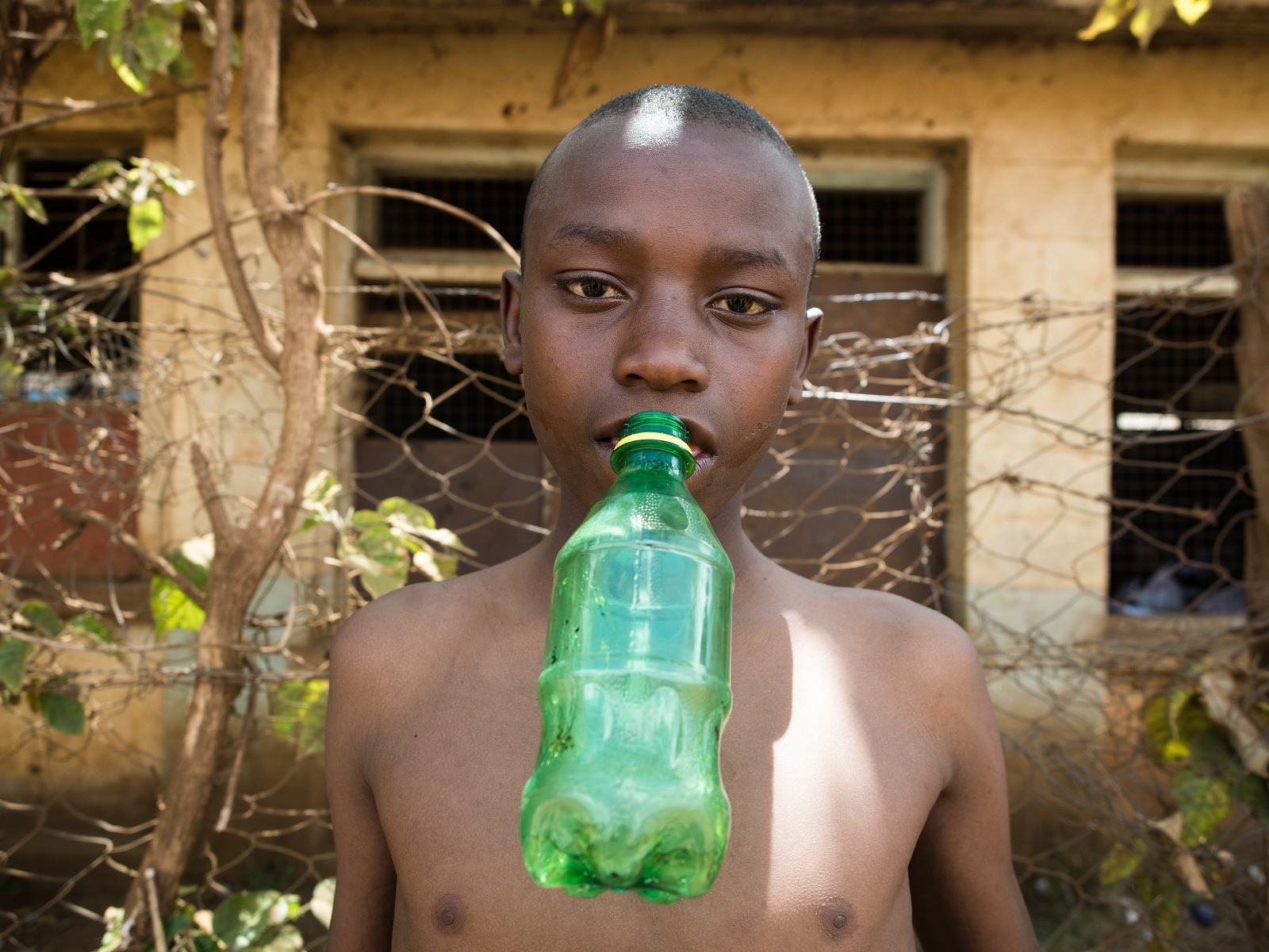 They hardly leave their bottle filled with glue aside. They usually put it between their chest and the t-shirt, letting the bottle comes out of the collar if they want to keep their hands free. He is Isaac